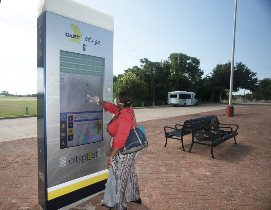 Customer tries out a DART interactive kiosk