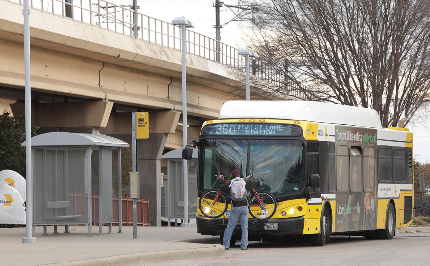 DART rider loading bike on bus
