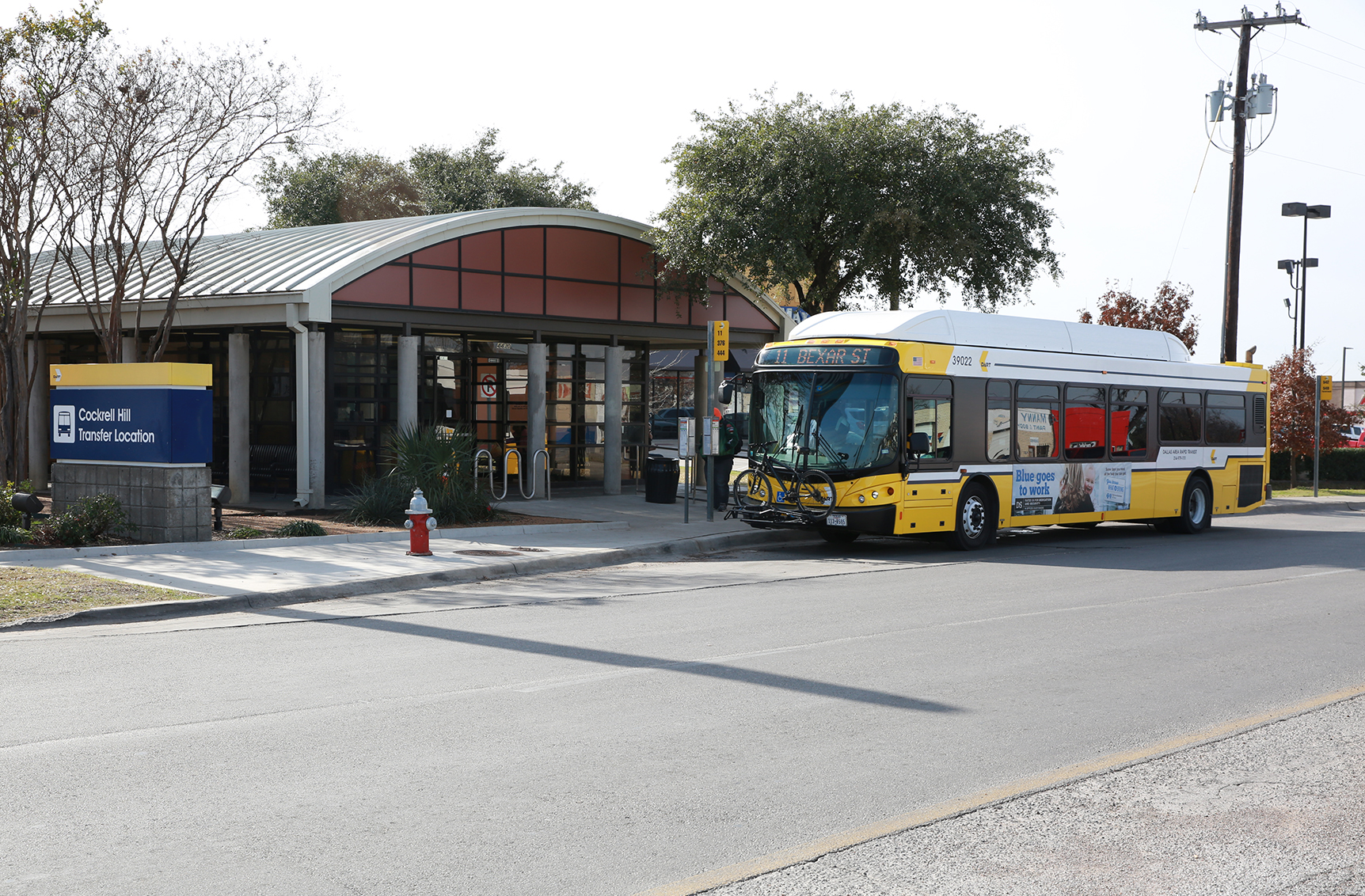 A DART bus waits for passengers at Cockrell Hill Transfer Location in Dallas.
