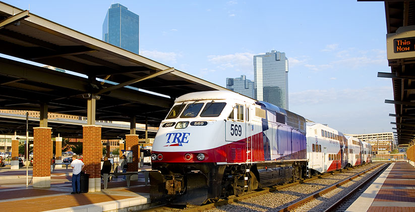 A Trinity Railway Express commuter train sits parked at Fort Worth Central Station in Fort Worth, Texas.
