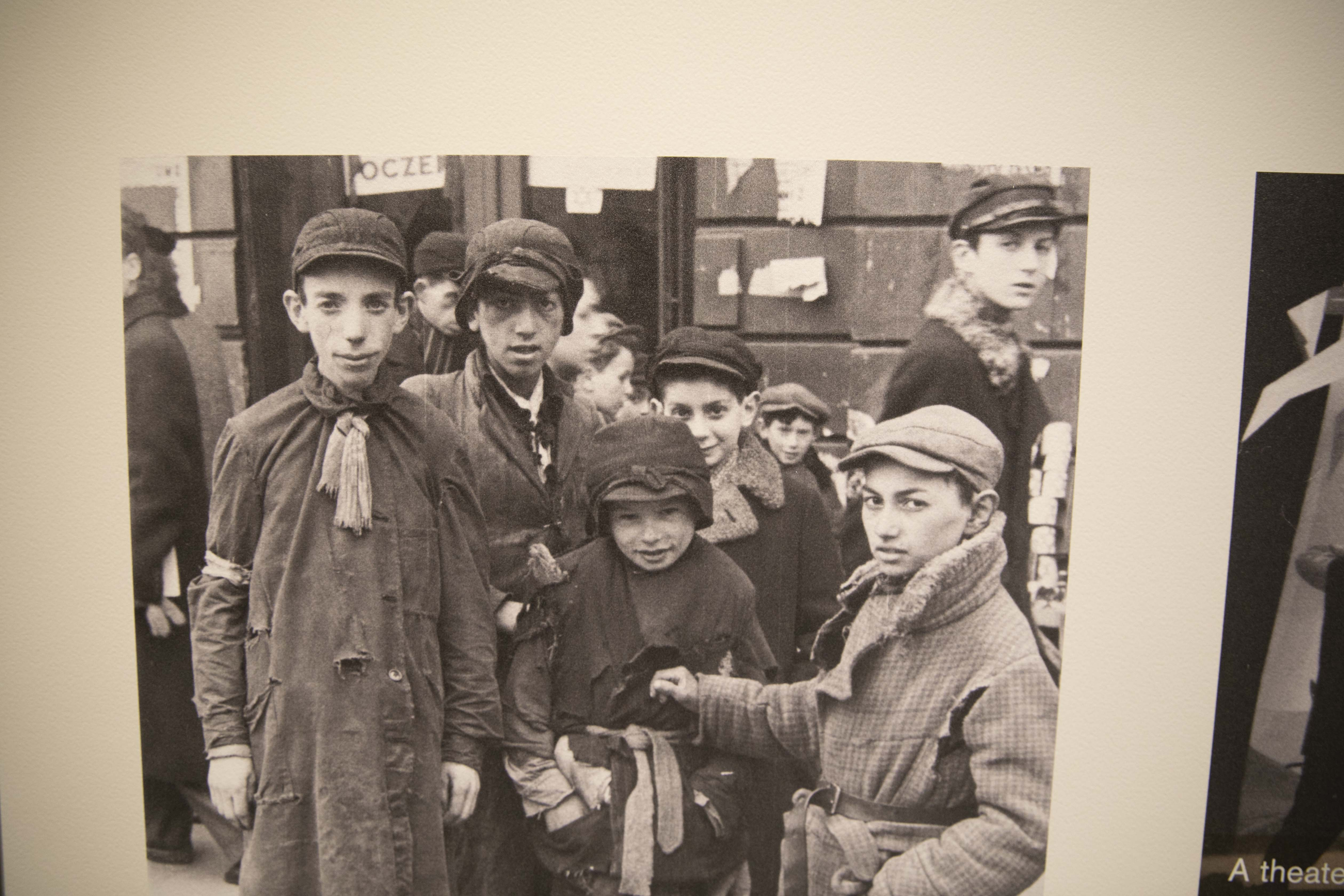 Holocaust survivor Max Glauben (fourth center from left with his face covered) stands with other boys in Warsaw, Poland before his family is deported to the Majdanek concentration camp in Poland. (Photo via Dallas Holocaust and Human Rights Museum)