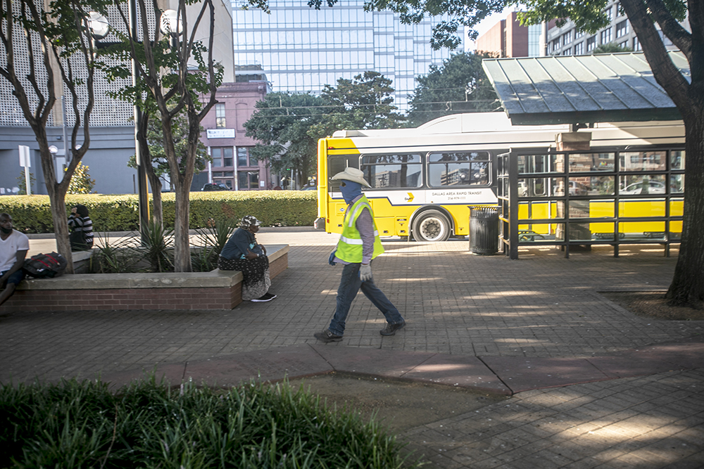 A man walks at the DART Central Business District West End Transfer Center in Dallas.
