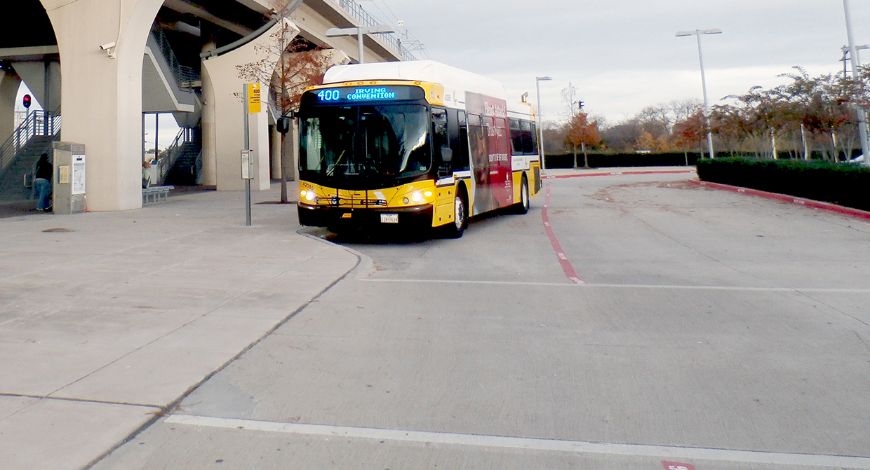 A DART Bus waits for passengers at Downtown Carrollton Station.