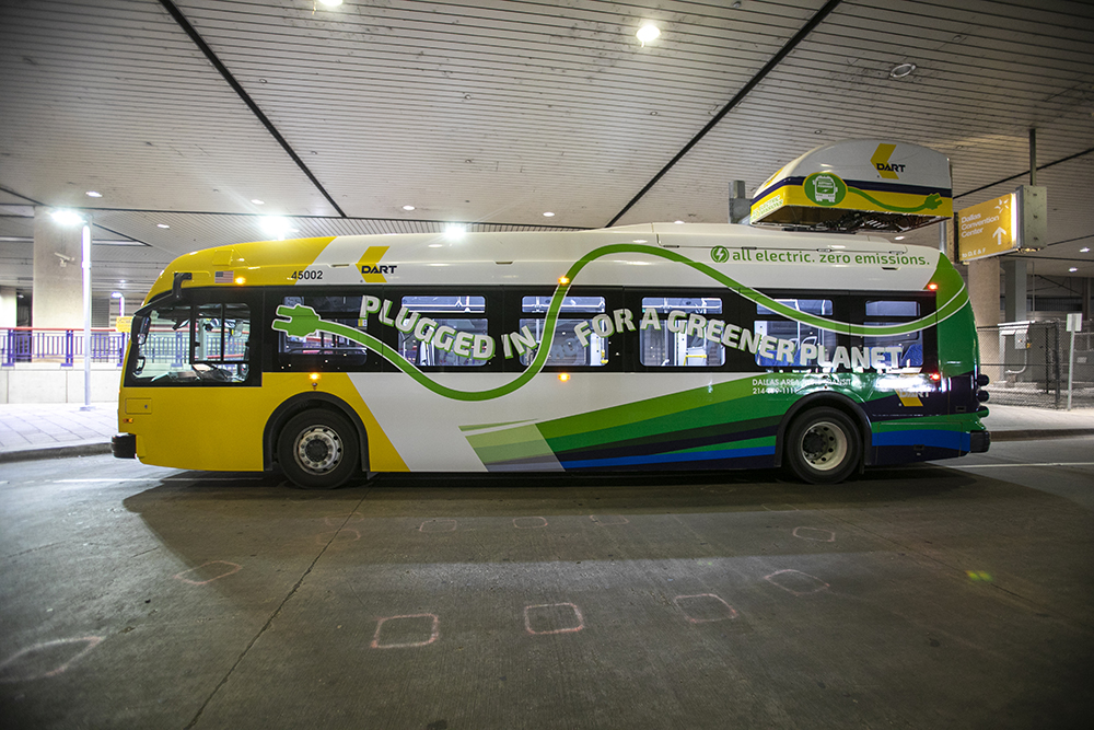 A DART electric bus sits parked at Convention Center Station.