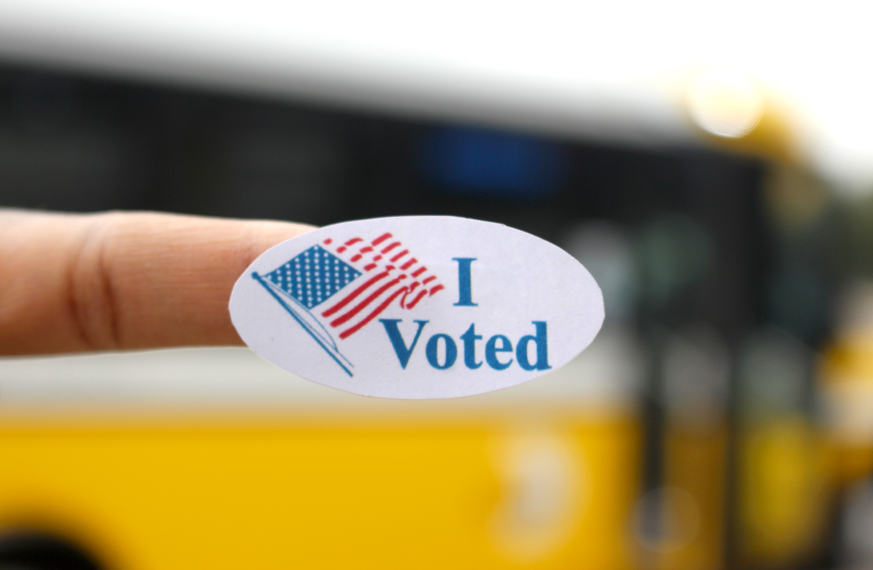 """An """"I voted"""" sticker near a DART bus at Belt Line Station in Irving."""