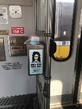 Mask dispenser on DART light rail vehicle.