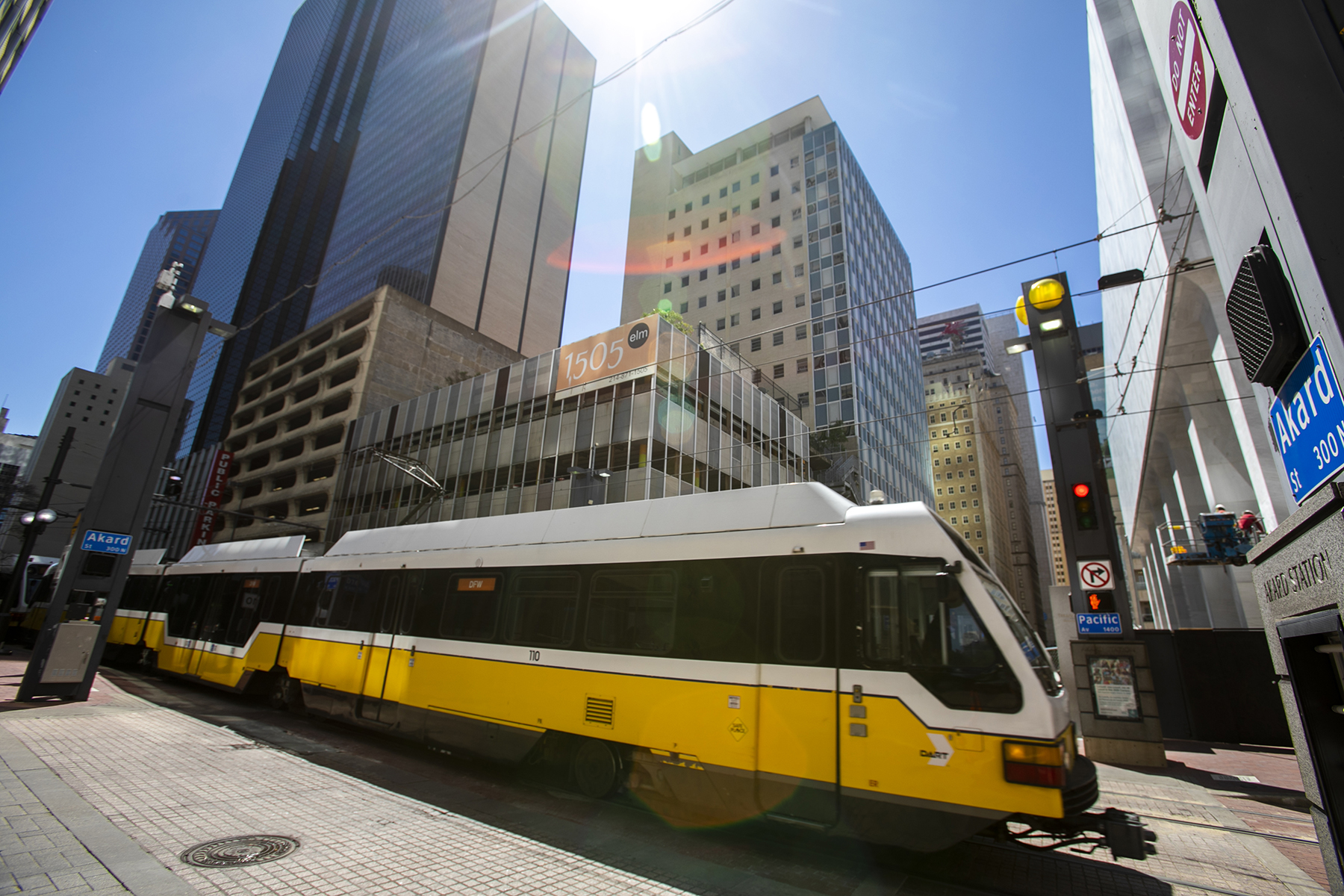 DART light rail vehicle approaches Akard Station in Dallas.