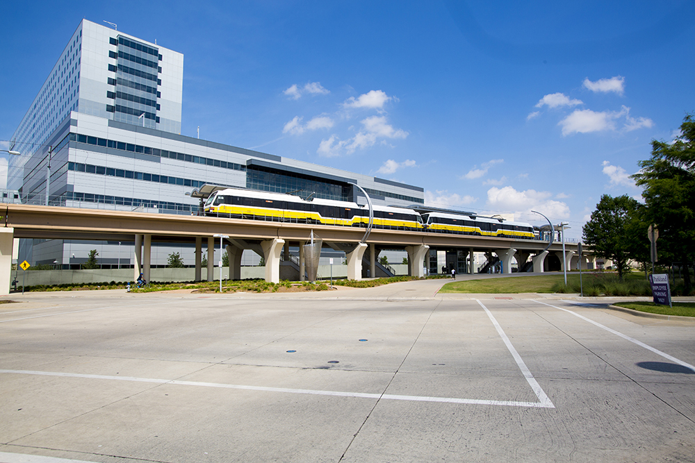 A DART train stops at Southwestern Medical District/Parkland Station.
